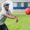 Benjamin Ojika, a mentor with YMCA, throws a ball at a baserunner during a kickball game at Tourtellotte Park on Thursday. Male mentors are in great need for the brother/sister program with the YMCA. Photo by Jackson Forderer