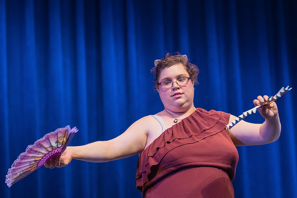 Heather Bell dances with a pair of fans during a rehearsal of Circus Metamorphosis held at Mankato West on Tuesday. The play is being put on by the Aktion Club Theater group, which is a community-based theater group for people of all abilities and ages. Photo by Jackson Forderer