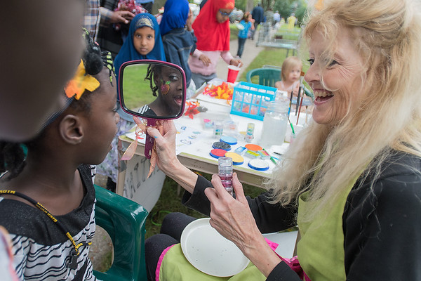 Karen Hoffman (right) shows Asha Mohammed, 7, her face painting at Washington Park during Night to Unite. Washington Park was just one of many locations that held neighborhood get togethers for the Night to Unite. Photo by Jackson Forderer