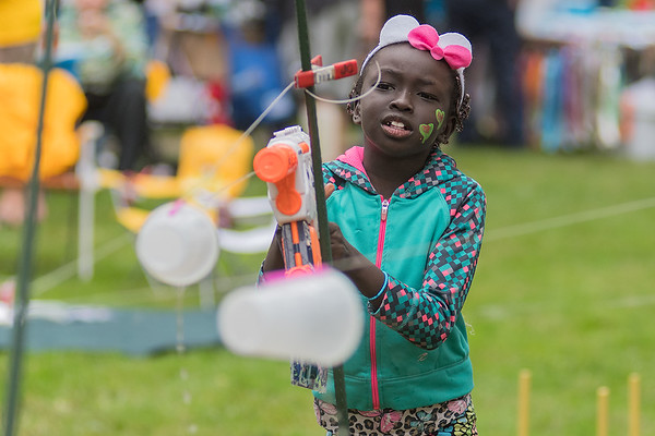 Jada James, 7, plays a squirt gun game at Washington Park during Night to Unite on Tuesday. Night to Unite is a crime and drug prevention program which helps residents get to know their neighbors and neighborhood. Photo by Jackson Forderer