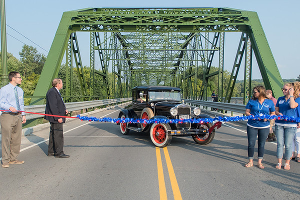 Erik Hansen drives his 1930 Model A Ford to the west end of the Highway 99 bridge in St. Peter during a celebration of the bridge on Tuesday. Photo by Jackson Forderer