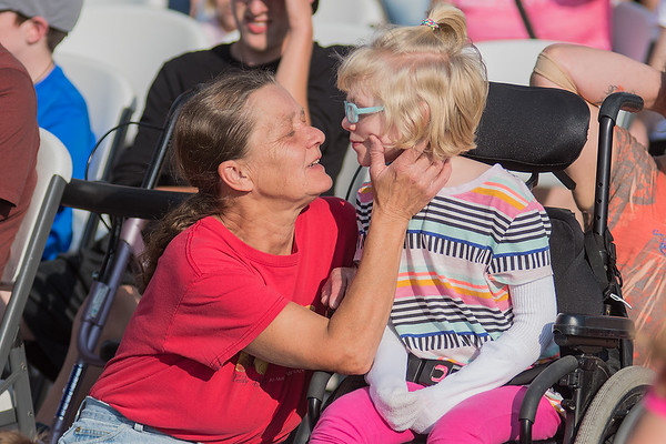 Janet Zuehlke (left) talks to Charlotte Modene, 9, before the Fallenstein Playground was opened to the public on Wednesday. Photo by Jackson Forderer
