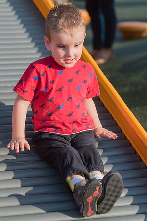 Henry Ireland, 3, goes down a slide at the newly opened Fallenstein Playground. Henry, who has spina bifida, said that his favorite part of the park was all of it. Photo by Jackson Forderer