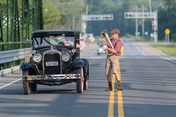 James Henry plays his euphonium while walking across the Highway 99 bridge in St. Peter as Erik Hansen drives his 1930 Model A Ford alongside him on Tuesday. The City of St. Peter held a small celebration for the bridge on Tuesday. Photo by Jackson Forderer