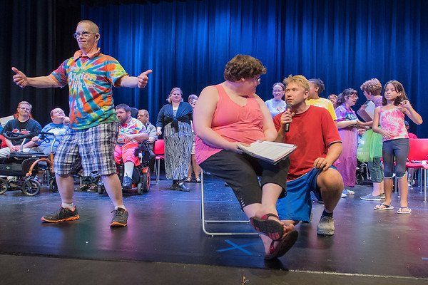 Eric Hix (kneeling) sings to Bridget Campbell as Randy Dittrich (left) and other cast members of Circus Metamorphosis dance to the song during the play's rehearsal at Mankato West. The play also features special guest artist Juan Felipe Herrera, the 21st Poet Laureate of the United States. Photo by Jackson Forderer