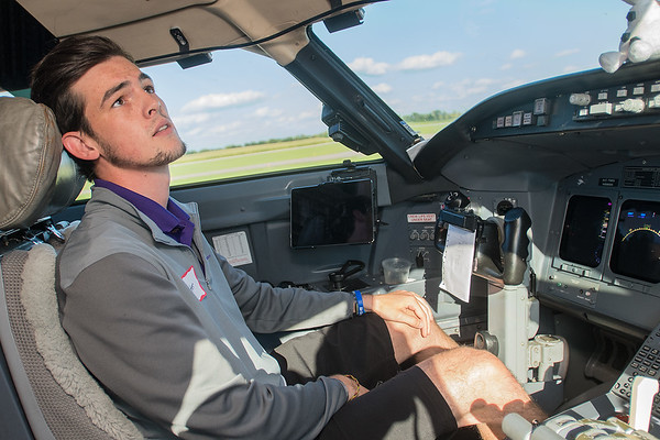 Carter Kes, a senior MSU student, looks around the cockpit   Photo by Jackson Forderer