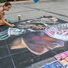 Kimberly Wood from St. Joseph, Mich. works on her piece of 3D chalk artwork at the first annual 3D Chalkfest. The event was held on Saturday from 10 a.m. to 2 p.m. in the Consolidated Communications parking lot. Photo by Jackson Forderer