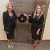 Sarah Person (left) and Maria Person of Exclusively Diamonds in front of the safe of the former Wells Federal Bank building. Exclusively Diamond will be moving into the building in October and plans to use the safe for their business. Photo by Jackson Forderer