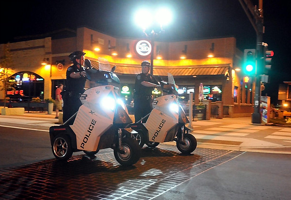 Mankato Public Safety officers Stephanie Wilkins and Justin Lindmeyer patrol downtown Mankato on motorized scooters Thursday evening. Extra police patrols will greet Minnesota State University students returning to the downtown entertainment district this weekend. Photo by Pat Christman