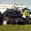 Emergency personnel use extrication tools to remove the occupants of a vehicle involved in a three-car crash about 8 a.m., Monday in the northbound lane of Highway 169 on the north edge of Mankato. The northbound lane of the highway was closed because of the crash. Photo by John Cross