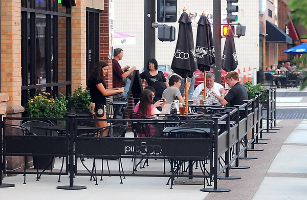 Pub 500 added 15 tables of seating in a new patio expansion. Owner Tom Frederick welcomes the added police presence downtown. Photo by Pat Christman
