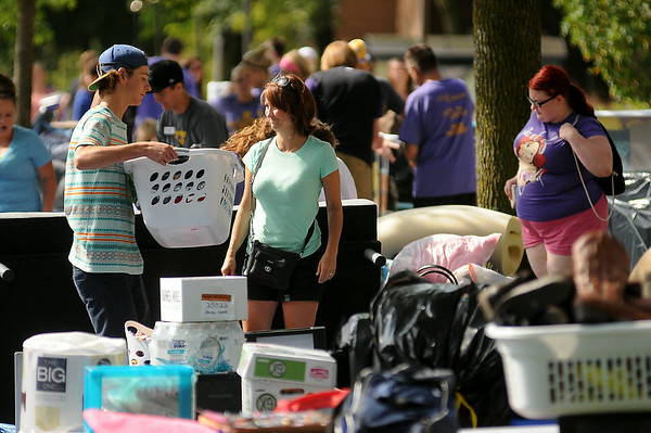 Students and parents unload belongings outside of McElroy Residence Hall during MSU's Move-In Day on Thursday. Photo by John Cross
