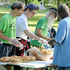 Members of the Washington Park Neighborhood Association hand out food during a Night to Unite gathering in Washington Park. Photo by Pat Christman