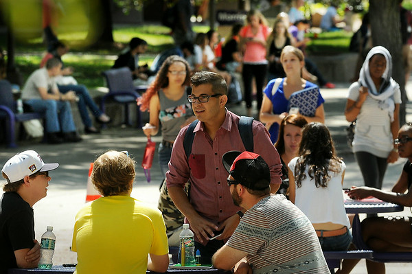 Students socialize between classes on the mall at Minnesota State University on Monday, the first day of the fall semester. More than 15,000 undergraduate and graduate students are attending MSU this fall. Photo by John Cross
