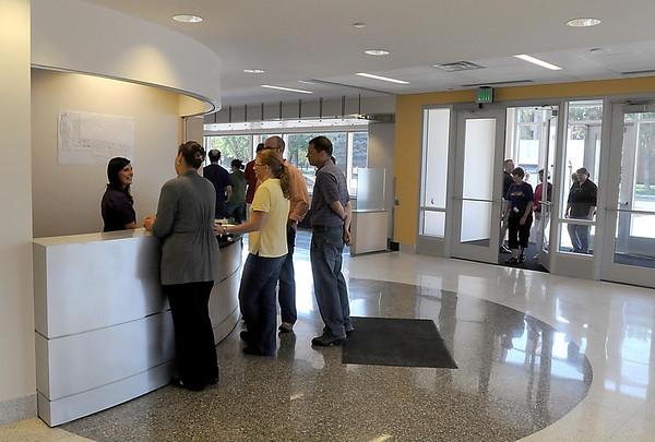 Visitors check out the front desk area of Preska Hall during an open house Friday.