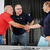 State Sen. Mike Parry (left) shakes hands with former state Rep. Allen Quist after Tuesday's Farmfest forum. Voters will decide Aug. 14 which Republican will advance to face Democratic Congressman Tim Walz (center) in the Nov. 6 general election.