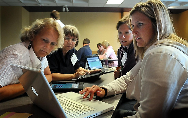 John Cross<br /> Front left, Kathy Abbott and Jeanette Barsness of Mankato Area Public Schools,  Stacy Collin of Waseca Public Schools and Tami Benson, also with Mankato Area Public Schools, work on developing an online Web site during a breakout session of a Technology Summit held Wednesday at MSU.