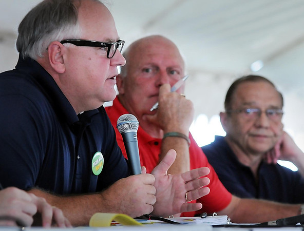 Democratic Congressman Tim Walz spoke to farmers at a forum in Redwood County Tuesday as Republican 1st District candidates Mike Parry and Allen Quist listened. It was a civil discussion with Parry and Quist rarely making any reference to each other one week before voters will decide which Republican becomes Walz's general election challenger.