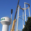 The new North Mankato water tower sits next to the old one as it is being dismantled Thursday.