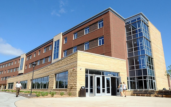 Visitors enter Preska Hall, the newest dorm on the Minnesota State University campus, during an open house Friday.