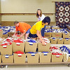 Bethlehem Lutheran church youth group members and volunteers load up some of the 4,000 backpacks full of school supplies they created this week as part of their Christ's Servants Involved (CSI) program. The group spent a week volunteering for area service organizations and creating school supply backpacks for Lutheran World Mission. Pat Christman
