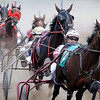 John Cross<br /> Horses and their drivers thunder around a turn during harness races Wednesday at the Nicollet County Fairgrounds in St. Peter. The fair continues through Sunday.