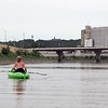 From left, Jeremy Alsdorf, Denise Bicknase and Diana Bicknase paddle down the Minnesota River near downtown Mankato on the way to Paddle Jam Saturday at Riverfront Park.