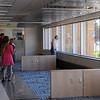 The front of Preska Hall boasts areas where students can work and relax near large windows.