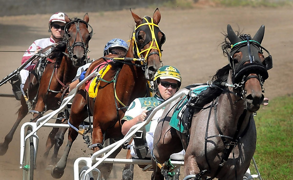 John Cross <br /> Harness racers roll around the track at the Nicollet County Fairgrounds on Tuesday, an annual kick-off for the event that runs through Sunday.