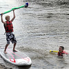 Pat Christman <br /> Aidan Kelling, 12, celebrates a stand up paddleboard jousting win over his older brother Kane, 15, during Paddle Jam Saturday at Riverfront Park.