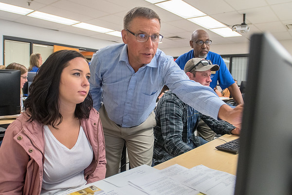 Madi Ziebell (left) gets help registering for classes from Professor Dave Hammit at South Central College on Wednesday. The registration day was part of a new business program at the college. Photo by Jackson Forderer