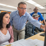Madi Ziebell (left) gets help registering for classes from Professor Dave Hammit at South Central College on Wednesday. The registration day was part of a new business program at the college ...
