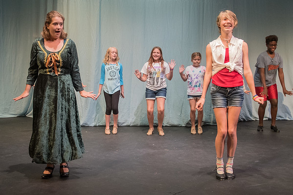 Shealyn Kawlewski, playing Fiona (left), dances with other cast members during a rehearsal of Shrek the Musical at Centenary Methodist Church. Photo by Jackson Forderer