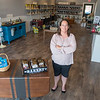 Lisa Phillips, the new owner of Arizona Olive Oil, in the business's new location on Belgrade Avenue in North Mankato. Phillips said she wants to have a variety of products in addition to the varieties of olive oil the business already sells. Photo by Jackson Forderer