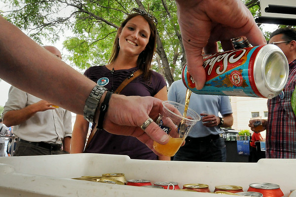 Elizabeth Harstad awaits a sample of Schell's beer while attending Alive After 5 at Jackson Park on Thursday. Three more of the free events which feature live music, food and drink are are scheduled for the next three Thursdays. Photo by John Cross