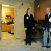 Open Door CEO Sarah Kruse (left) shows Tom Lentz and Jolene Wall of Bremer Bank one of the new medical exam suits in the renovated Open Door Clinic on Wednesday. The clinic received a $250,000 gift from the Otto Bremer Foundation. Photo by John Cross