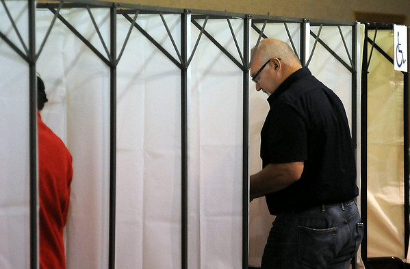 Russ Chapek votes during Tuesday's primary election at the Lake Crystal polling site. A school referendum for Lake Crystal-Wellcome Memorial Schools was included on the ballot in that community. Photo by John Cross
