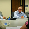 "Rep. Tim Walz is flanked  by Pat Cline, director of community relations and economic development with Xcel Energy (left), and Bob Ambrose, director of government affairs with Great River Energy during a meeting in Mankato on Thursday. Walz discussed energy policy and presented a ""I hire vets"" certificate to Xcel Energy to recognize their efforts to hire veterans. Photo by John Cross"
