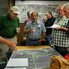 Blue Earth County associate engineer Gene Haefner (left) visits with residents about County Road 12 extension plans during an open house at the Blue Earth Public Works building on Tuesday. Photo by John Cross