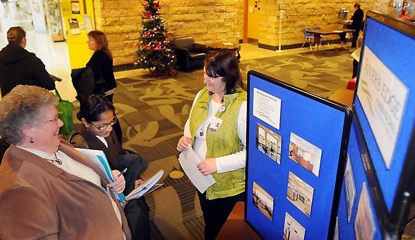 John Cross<br /> South Central College students Becky Gesche (left), and Anulipi Roy (center), visit the Paula Meskan, Director of Nursing at Rivers Edge Hospital in St. Peter, at a Healthcare Jobs Fair at SCC on Wednesday. Representatives from more than 25 health care institutions were represented at the event.