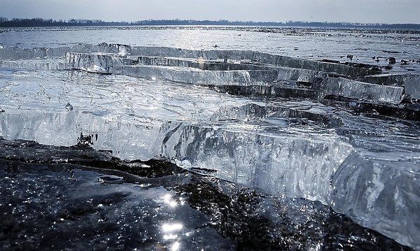 John Cross<br /> Wind-driven, two-inch-thick shards of ice stack up along the northeast shore of Lake Elysian, Monday. About the only people who might regard recent temperatures in the 50s that more suitable to April than December as a set-back are ice-fishing enthusiasts.
