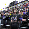 Minnesota State University offensive lineman Chris Reed gets a kiss from his girlfriend Anna Ryan after the Mavericks defeated Missouri Western State in the NCAA Division II football national quarterfinals Saturday at Blakeslee Stadium.