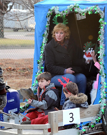 Kim Wussow gets ready for Saturday's fish house parade with her grandchildren Oliver (left) and Gus Schweim.