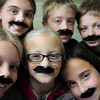 Students at Bridges Community School show off their fake mustaches, a school-wide effort on Friday to show support for Kobi Schuck's (front center) father, Wes Schuck, who has been diagonosed with stage four colon cancer. A Mustache Bash  fundraiser was held Friday night to benefit Schuck and his family. Front row, from left are Hannah Snyder, Schuck, and  Megan Hiniker; back row, from left, Elie Palesotti, Josh Roise and Will Simmons,