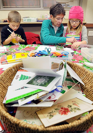 John Cross<br /> Jo Robbins helps her grandchildren, Jack and Rylie Hansen, <br /> make Christmas cards at the North Mankato Library on Tuesday. Library patrons made holiday cards on Monday and Tuesday that would sent to the American Red Cross to be distributed to those serving in the military.