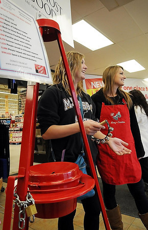 John Cross<br /> Salvation Army volunteer bell ringers Sammy Tidd (left) and Rachel Ellison greet shoppers at a Mankato grocery store.