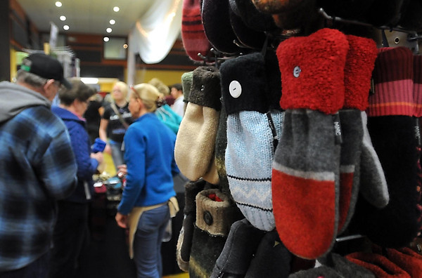 Pat Christman<br /> Shoppers look at mittens made from sweaters Friday at New Ulm's Christkindlmarkt.