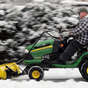 John Cross<br /> Kurt Evans makes quick work of clearing a sidewalk near Holy Rosary Catholic Church in North Mankato of the light snow that fell Wednesday.