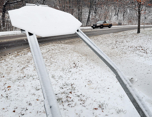 John Cross<br /> A sign at the bottom of the Parkway Avenue hill is askew , the casualty of a runway car on the steep hill after Wednesday's snow slickened streets.