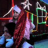 Anya Goblirsch, 2, sits atop her mother Natasha's shoulders as they check out the Canadian Pacific Holiday Train during its stop in New Ulm Wednesday. A band played music during the stop and volunteers collected food and donations for local food shelves.